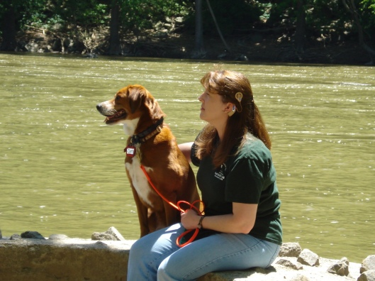 Denise and Chloe sit next to the Potomac at Harper's Ferry, WV